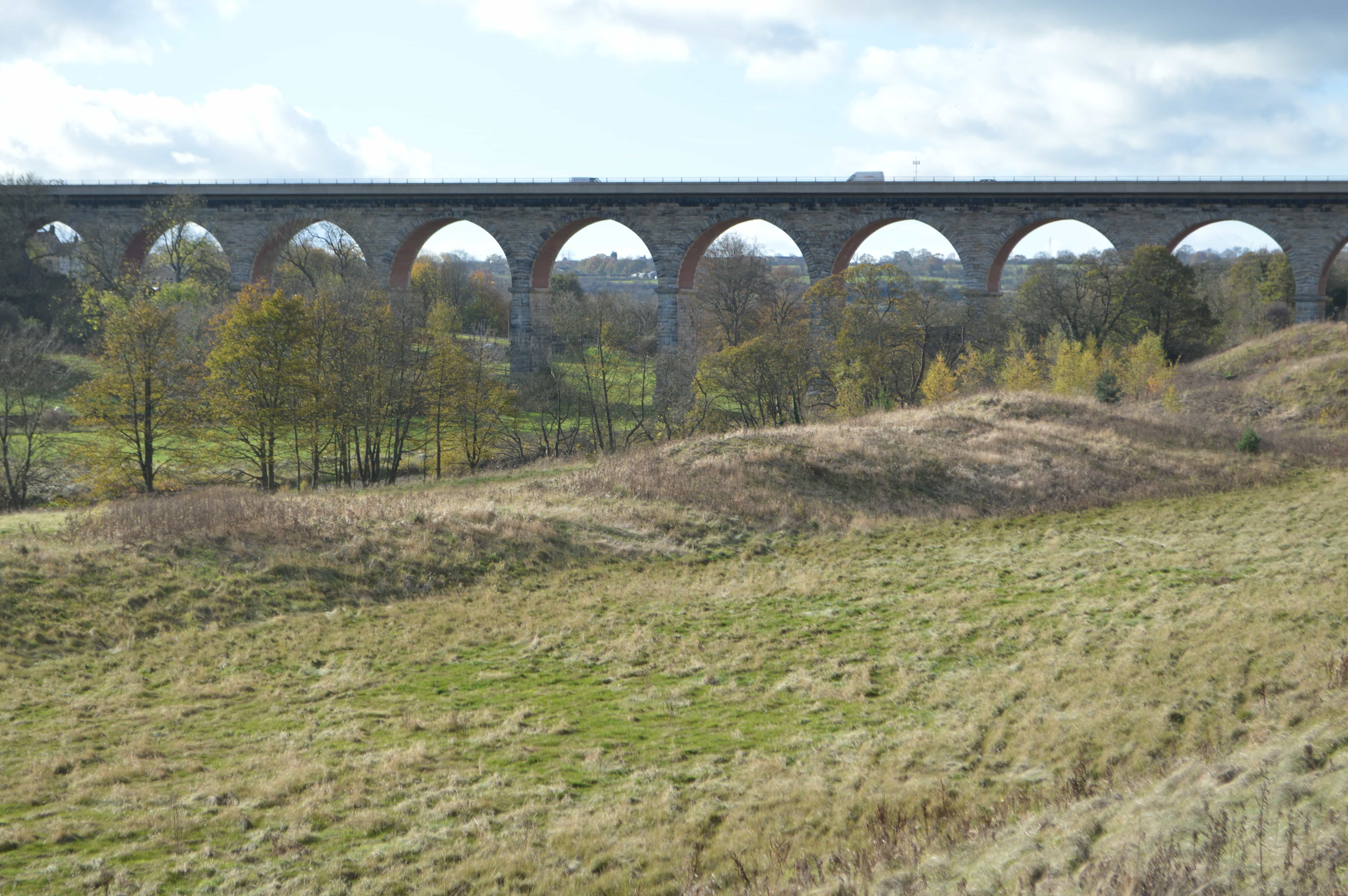 Shot of the 11 gothic arches of Bishop Auckland Viiaduct towering over the valley of the Wear